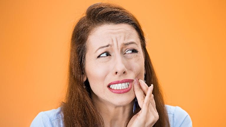 Woman with Tooth Pain | Modern American Dentistry