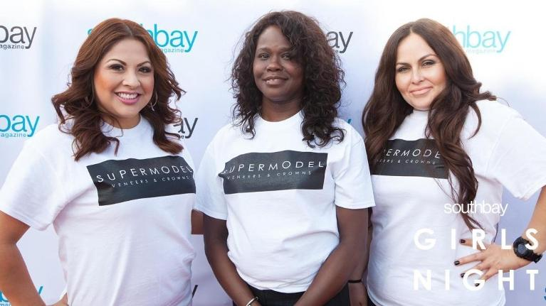 Three women wearing shirts that say Supermodel Veneers and crowns