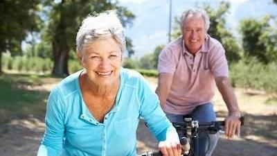 older man and woman riding bikes | woodland hills ca dentist